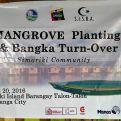 Pancarta de la ceremonia de entrega de las barcas y plantación de manglares